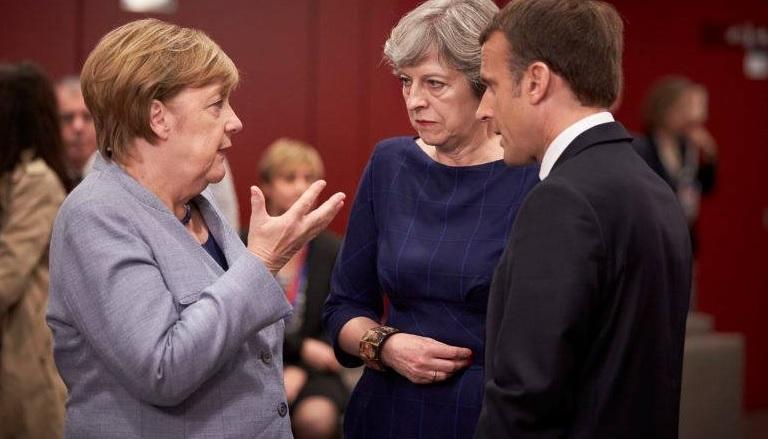 Бритaниa Аҧызa-министр Ангелa Меркели Еммaнуель Мaкрони рҟны aилaцәaжәaрaқәa мҩaҧылгиот