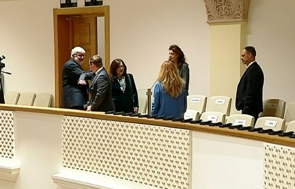 Diplomats in Parliament refrain from shaking hands when greeting politicians (VIDEO)
