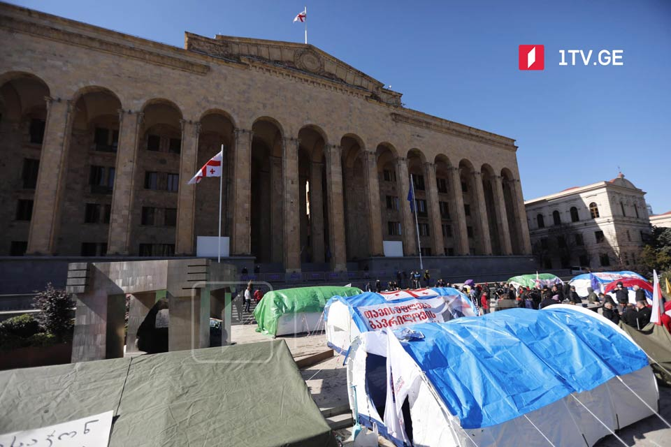 Opposition supporters set up another tent at parliament