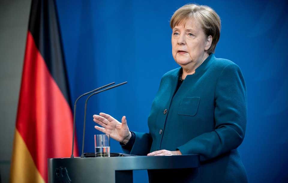 Angela Merkel əhalini əlaqələrin məhdudlaşdırlmasına və xaricə səyahətdən tərəddüd etməyə çağırır